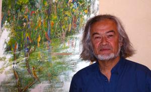 Alain présente une de ses oeuvres dans un quartier de la ville de Rennes