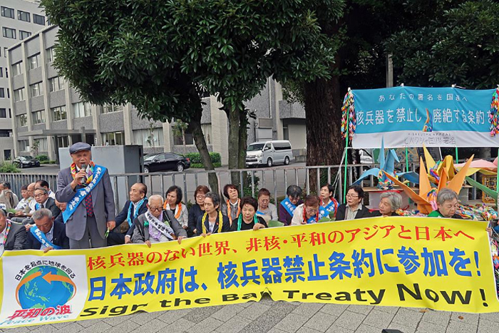 Fifty-seven Hibakusha join the sit-in and urge PM Abe to sign the treaty.